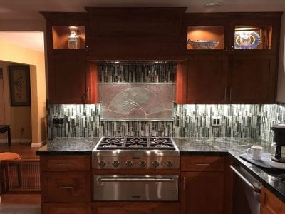 Modern dark kitchen remodel with black granite and dark cabinets