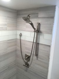 new shower head inside shower remodel