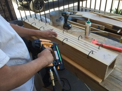 Licensed contractor in Tracy holds drill during construction