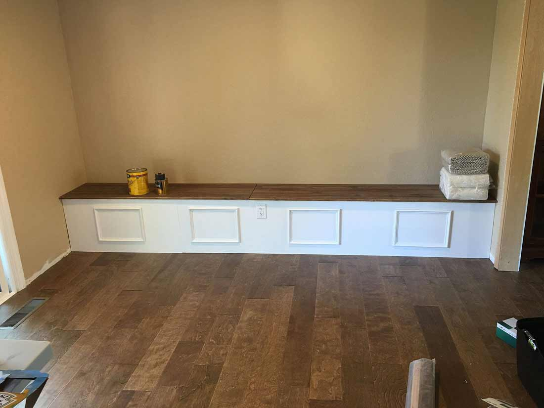 New bench seating installed with white paneling