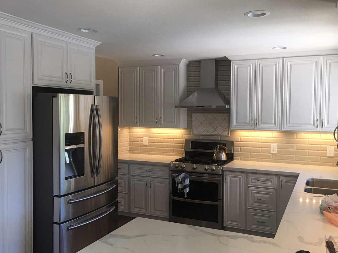 Modern kitchen with off white cabinets