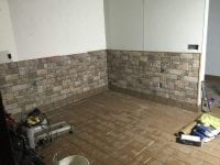 Stone walls and new flooring during living room remodel