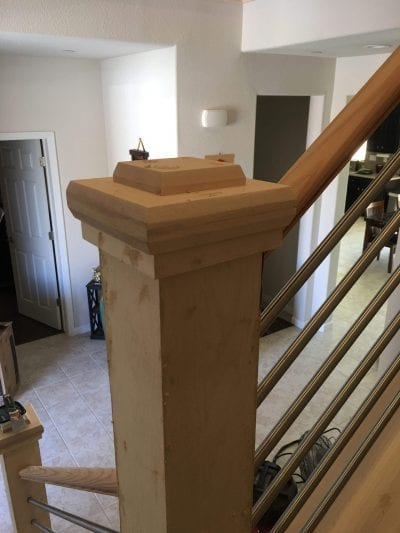 during a staircase remodel with metal railing
