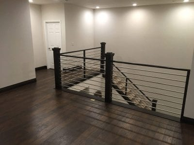new staircase with metal railing