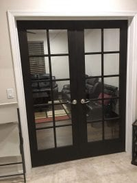 interior door with glass panels and dark wood