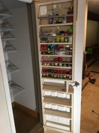 custom pantry shelving with spice racks on door