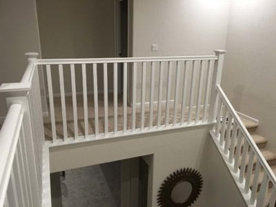 New white stair railing installed in Tracy, upstairs