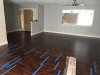 New laminate flooring inside Tracy home