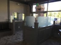 restaurant entrance with glass partition at De Afghanan in Tracy, California