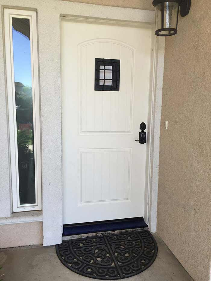New front door with small window and lock