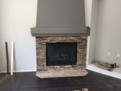 Fireplace remodel with stone and new hood