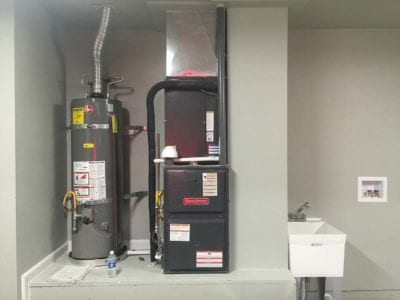 Water heater and furnace inside a garage in Tracy