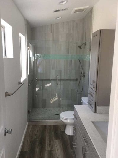 Bathroom remodel in Tracy, CA with new flooring, toilet, shower, sink, custom cabinets and tile work