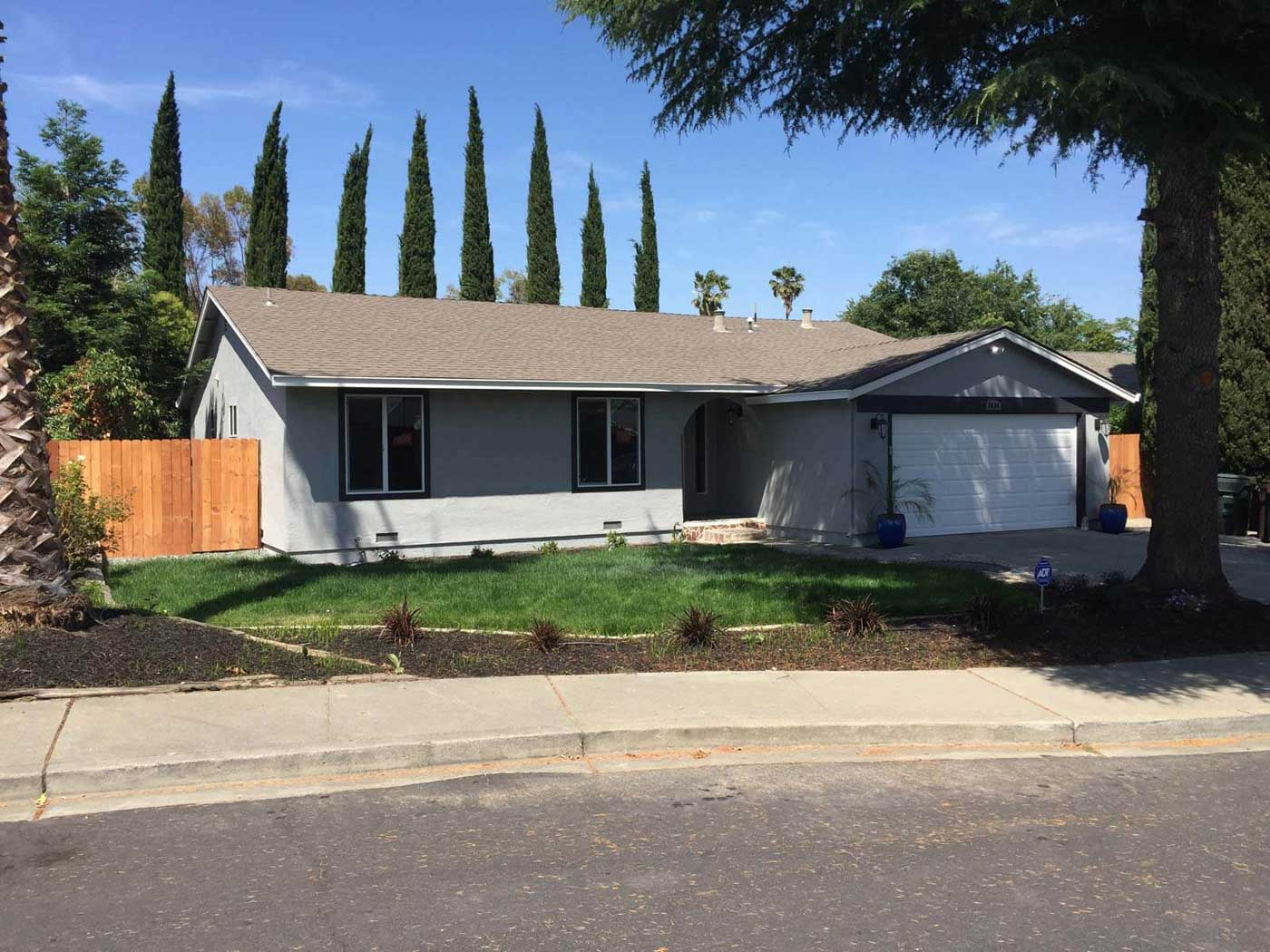 Front yard of Tracy home with new fencing