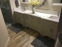 bathroom sinks with custom cabinetry and hardwood flooring