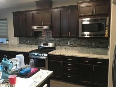 Dark cabinets and new backsplash after kitchen remodel