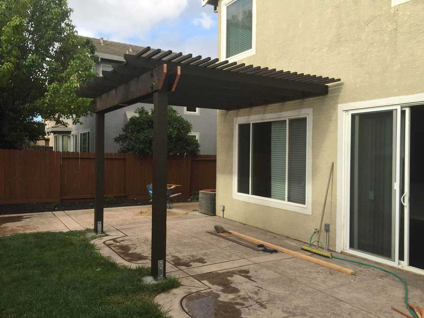 Newly installed attached pergola in Tracy
