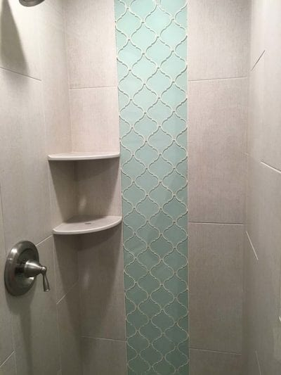 Light aquamarine wall tile inside shower remodel