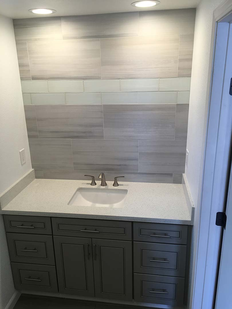 Like aquamarine tile above sink remodel with dark cabinets
