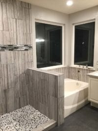 New floor and wall tile during shower remodel