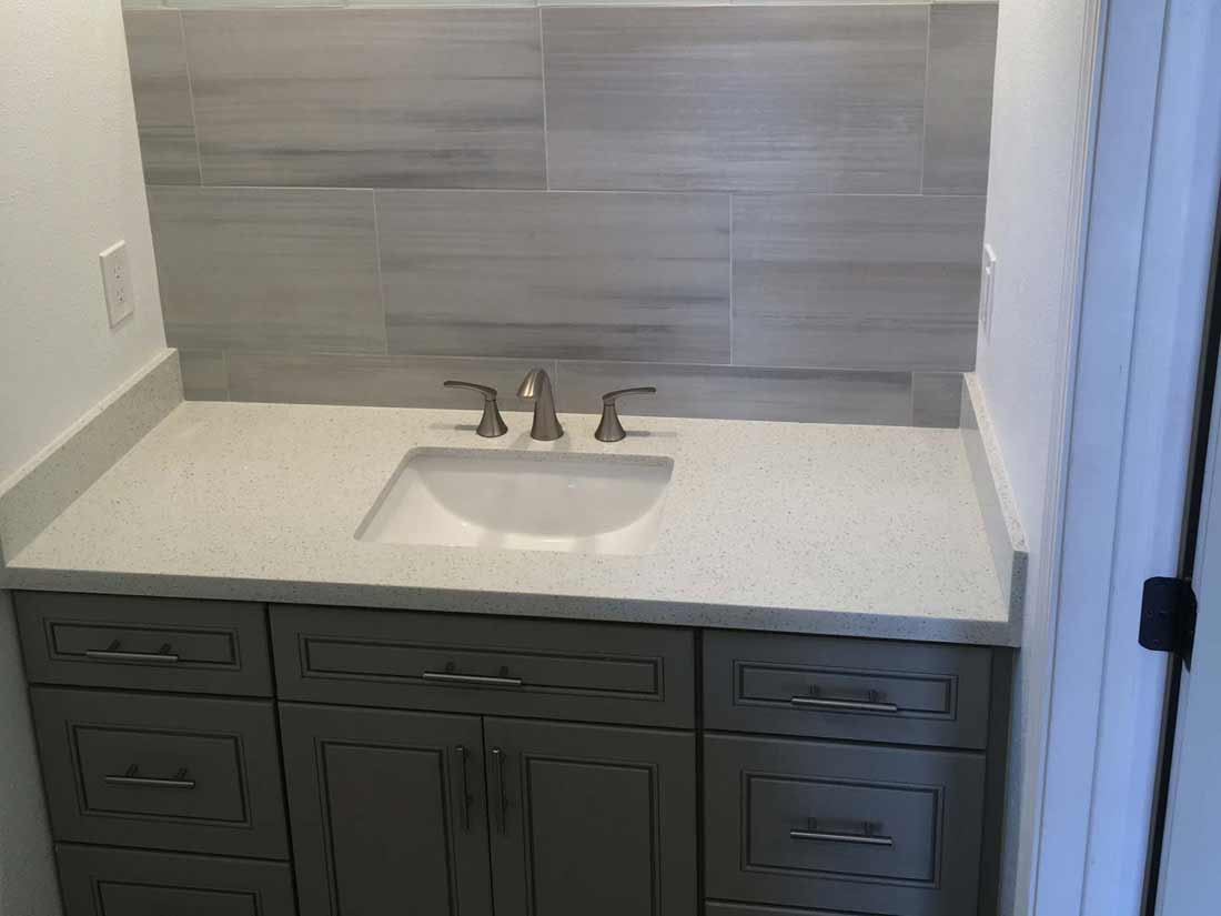 Bathroom remodel with new sink and cabinetry