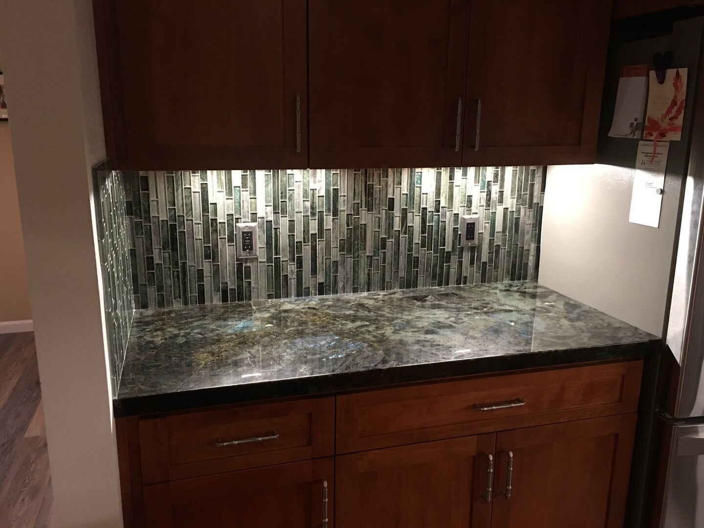 backsplash detail with vertical tiling matching the countertop