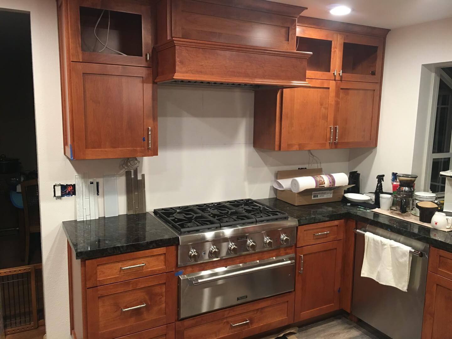 kitchen remodeling in progress with large gas stove