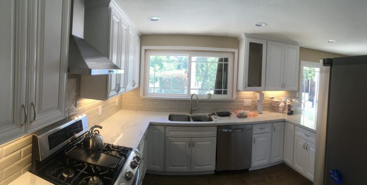modern kitchen remodel with white kitchen cabinets and stainless steel appliances