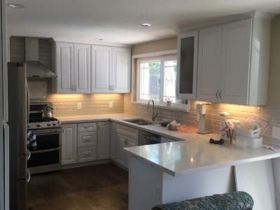 kitchen with white custom cabinets