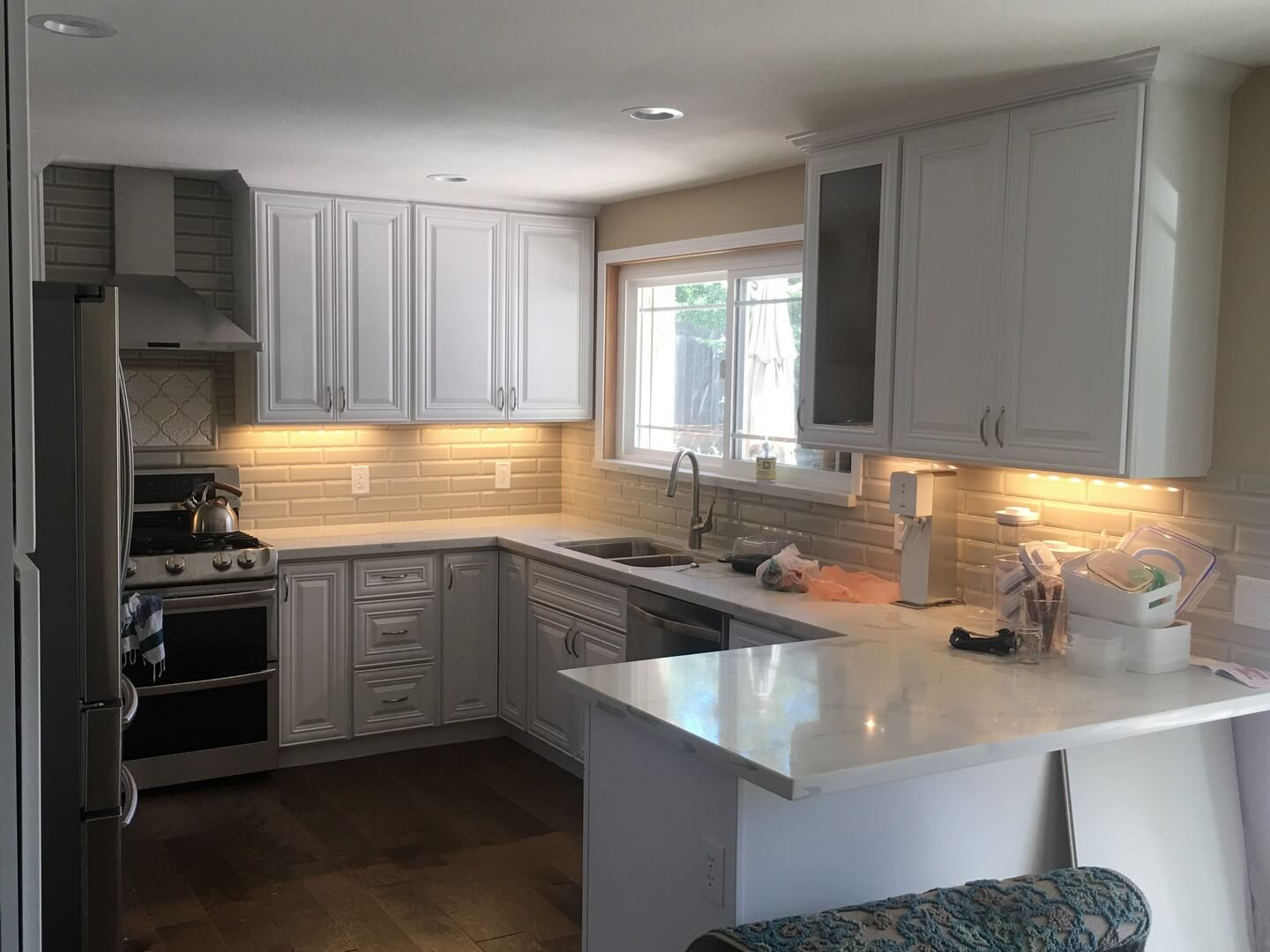 kitchen remodel with white custom cabinets