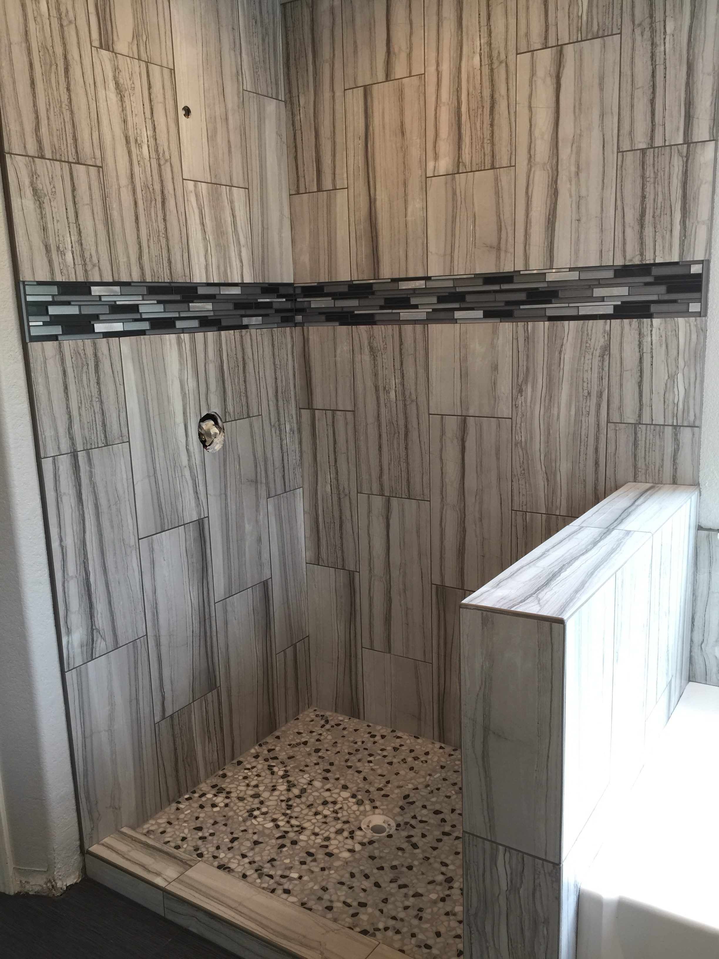 Shower wall tile progress during remodel in Tracy