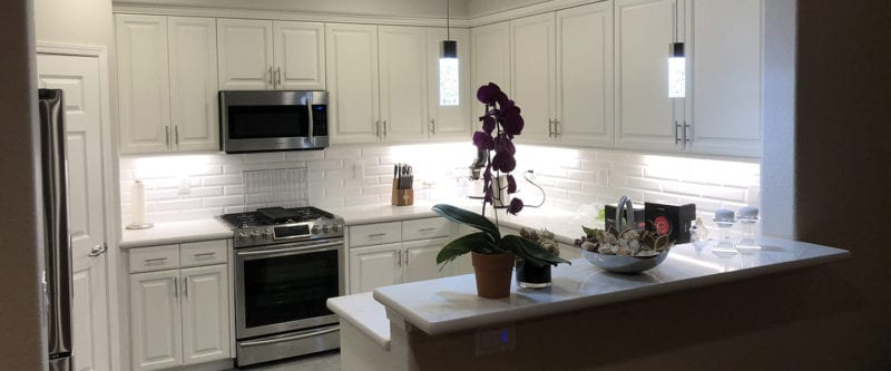 Kitchen remodel in Tracy with white cabinets and backsplash