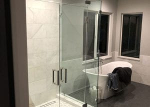 free standing tub and glass walk-in shower
