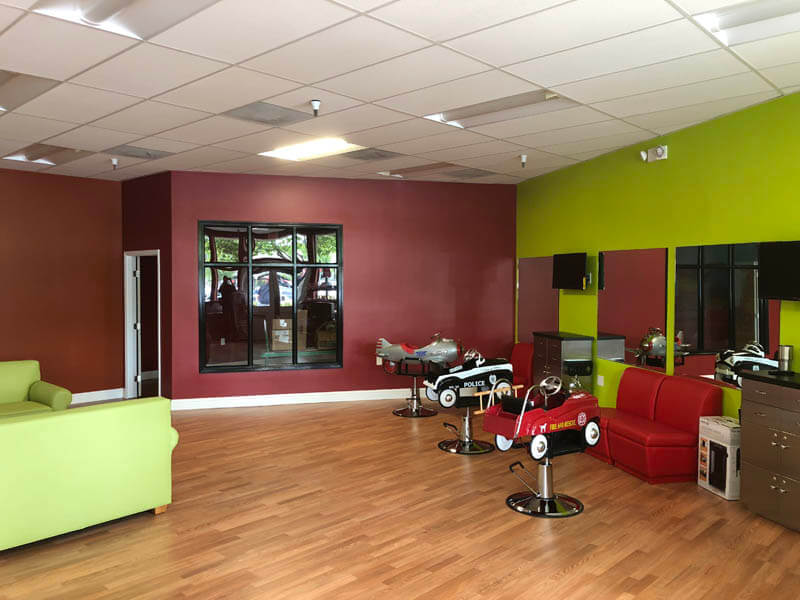 kids hair salon in Danville with car style seats, green and red walls