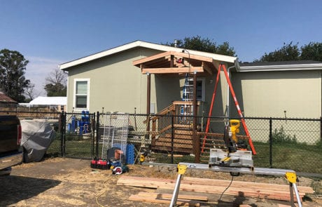construction of small deck on modular home from Trex decking
