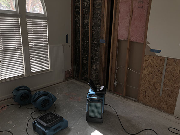 drying equipment set up in room during water damage restoration